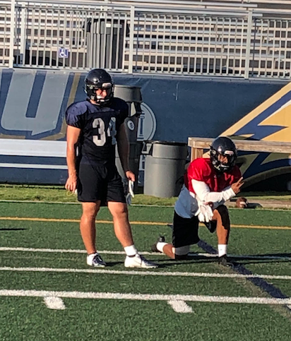 Connor Showalter and Octavious Ross watching a drill during practice.