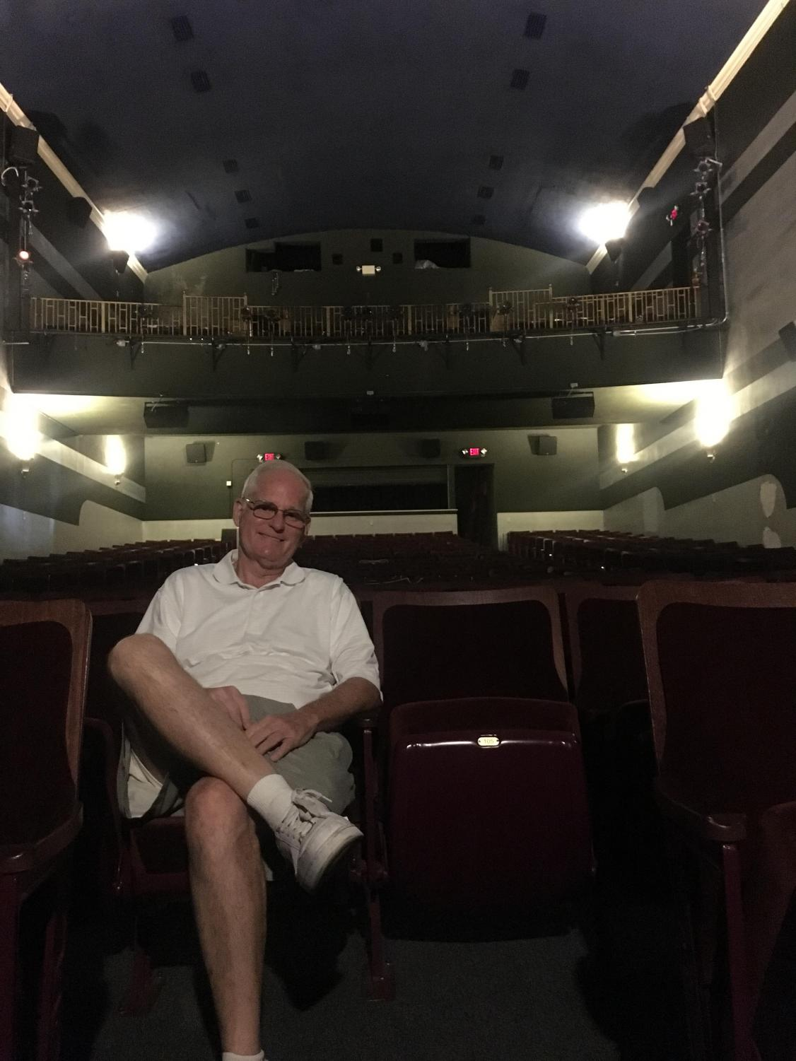 Wayne Alan, World Champion Magician, sitting inside the historic North Theater.