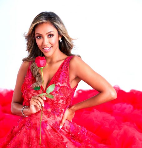 The Bachelorette, Tayshia Adams, posing with her rose for a Bachelorette photoshoot.