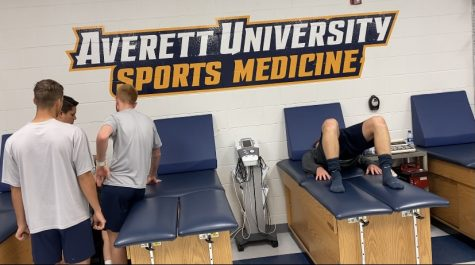 Averett student-athletes receiving treatment by athletic trainer in the ATR at North Campus.