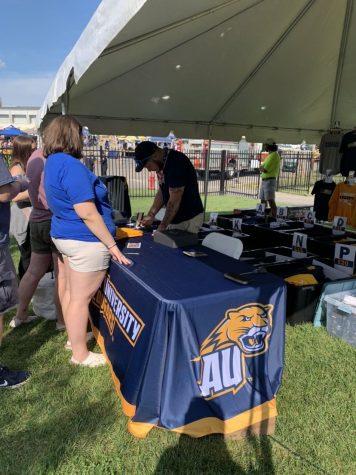 Dillon Weaver sells Averett merchandise at a football game